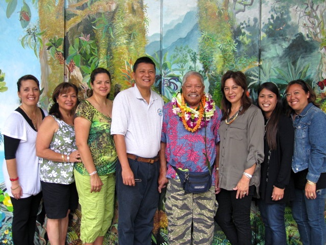 "Ka 'Ohana O Kalaupapa President Clarence ""Boogie"" Kahilihiwa surrounded by 5th grade teachers at Kamehameha Schools Kapalama campus in 2011. The 'Ohana worked with the teachers and students to produce the play, ""Ka 'Ohana O Kalaupapa."" Photo courtesy of Mara Bacon Chang"
