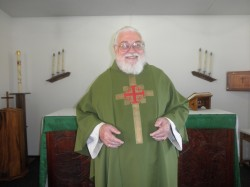Father Bob Walden in Grace Episcopal church.  Photo Contributed: by Nita Bogart