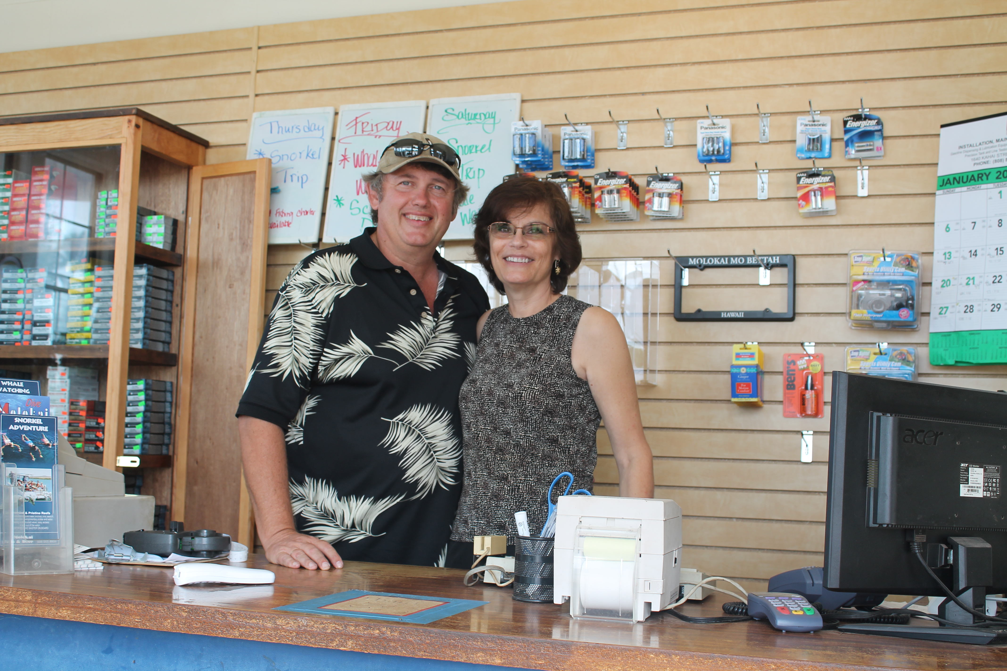 Tim and Susan Forsberg stand at the counter of the Fish and Dive's new location.